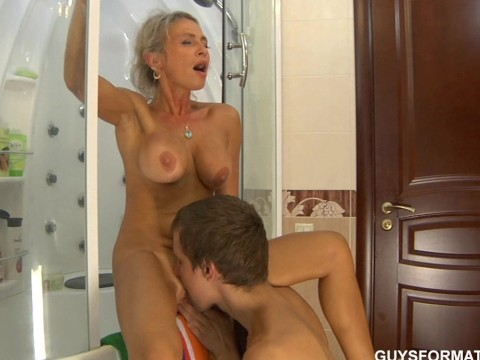 A young guy satisfies a mature milf with hot fuck and cunnilingus