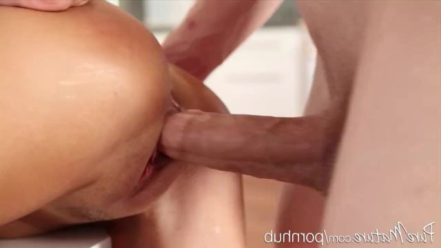 Apron failed to cover young blonde milf's ass and guy fucked her on the table