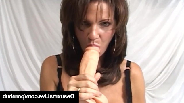 Beautiful brunette milf Deuxma showed her talent in masturbation