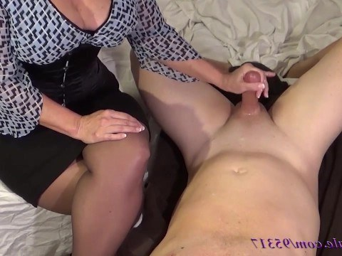 Caring mom is jerking her beloved son off so that he does not masturbate alone