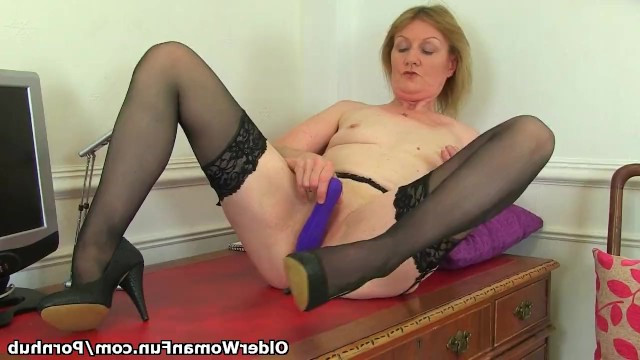 Granny secretary relaxing from work at the computer masturbating her pussy