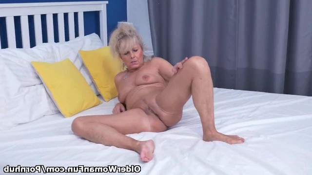 Hot gilf openly poses for the camera and gently masturbates her wet pussy