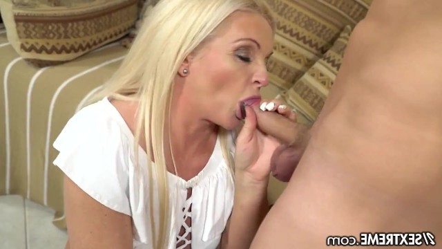Hot mature granny entertains a young guy with blowjob and pussy fucking