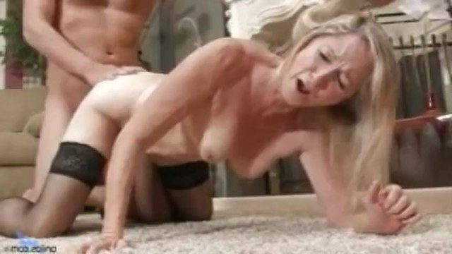 Mature blonde mom dived into guy's pants and demanded his dick for bonking