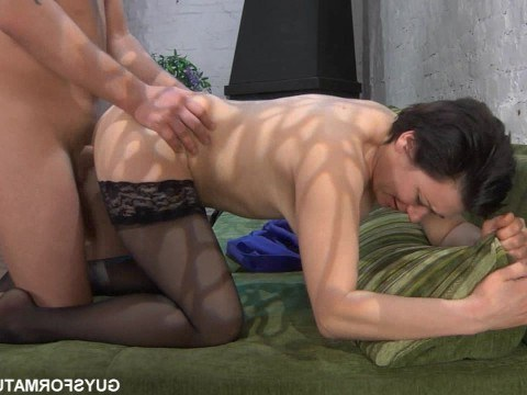 Mature brunette relieves the guy from a hangover by having great sex on the couch