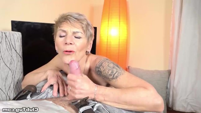Mature granny helps her grandson to cum by masturbating his young cock