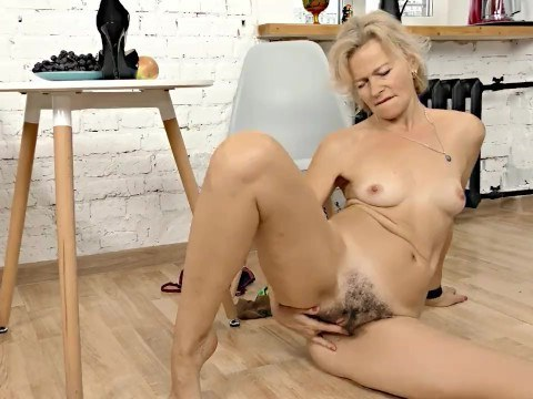 Mature lady was sick and tired of her lifestyle of the housewife and began to jerk her hairy pussy