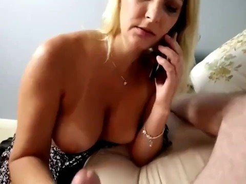 Mature milf talking with her husband on the phone and making cool blowjob to son