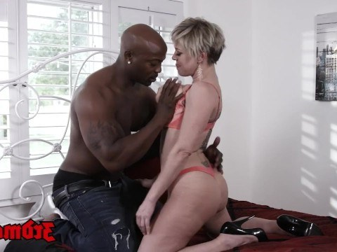 Mature mom realizes her sexual dreams in the bed with a black man