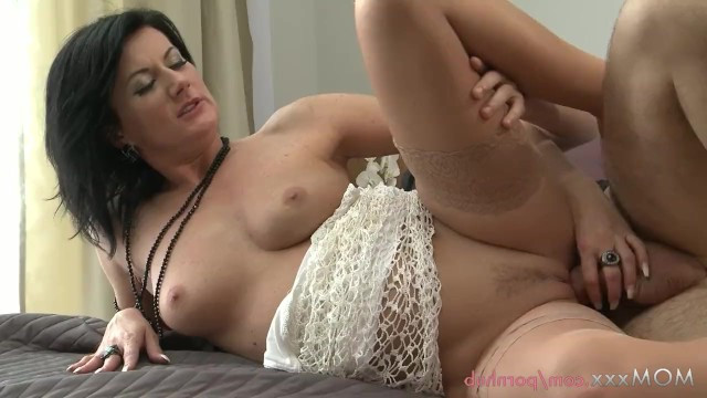 Mature Olivia cheats on her husband during a business trip and gets an orgasm