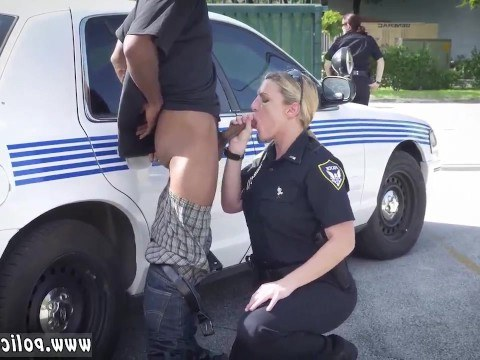 Mature policewoman took the law into her own hands with a detained black man giving him a blowjob