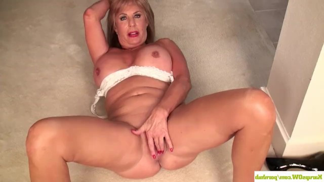 Mature woman masturbates in front of the camera, showing off her accumulated experience