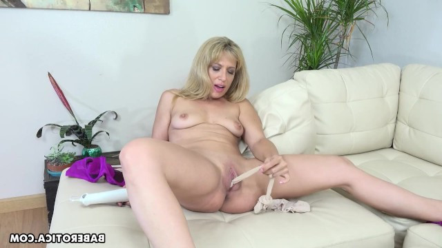 Milf shoved her pantyhose into her pussy and began to masturbate with the help of a vibrator