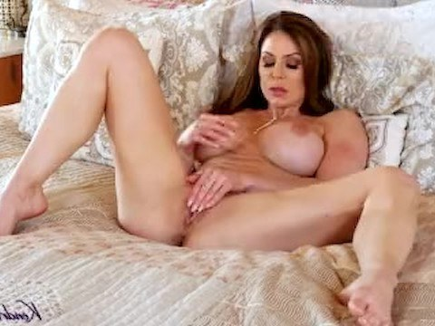 Stunning milf brings herself to orgasm while jerking in bed